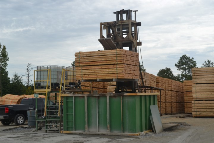 Landscape lumber being dipped
