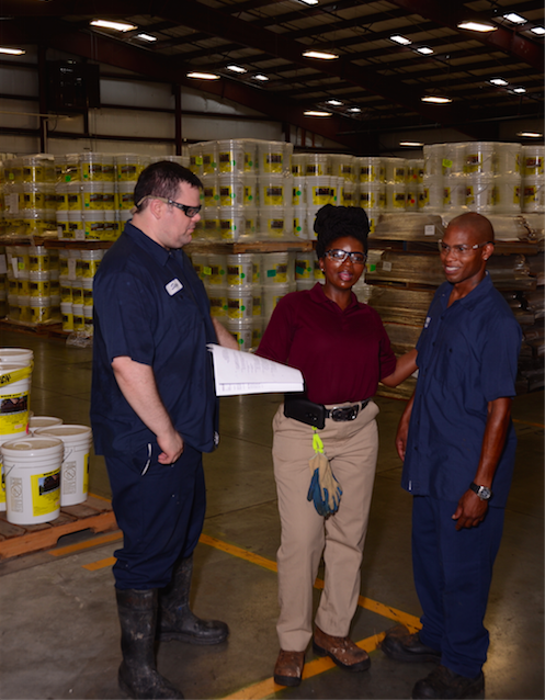 Three employees in warehouse